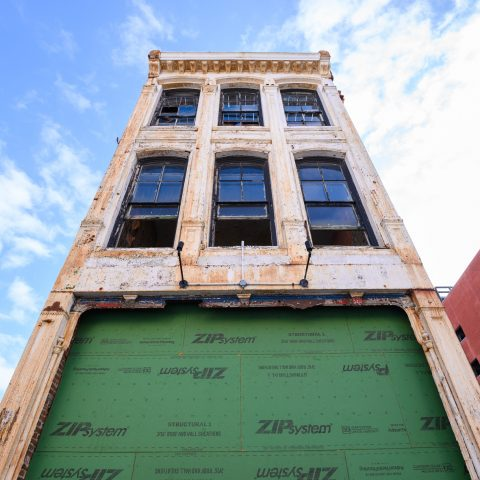 Historic building in Wilmington, DE with weathered exterior and tall windows on a sunny day