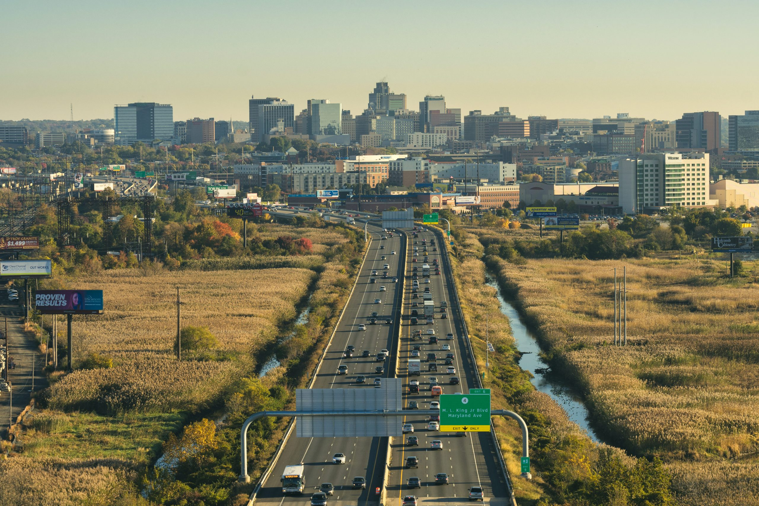 Aerial view of highway leading into city landscape of Wilmington, DE