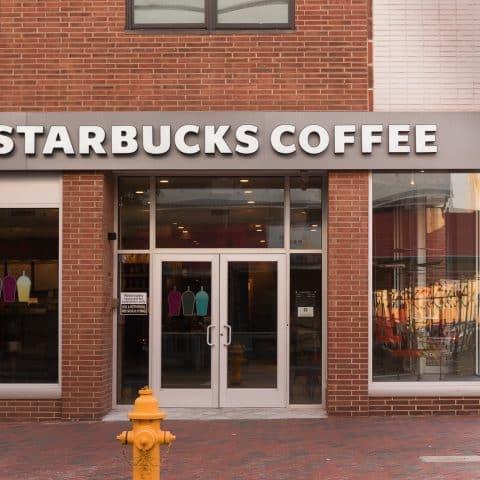 Exterior of Starbucks Coffee on a street corner on a sunny monring
